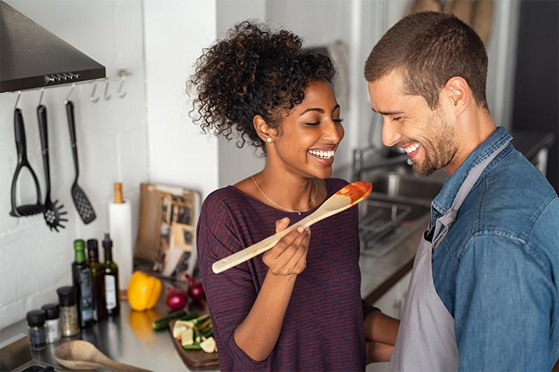 Couple tasting food