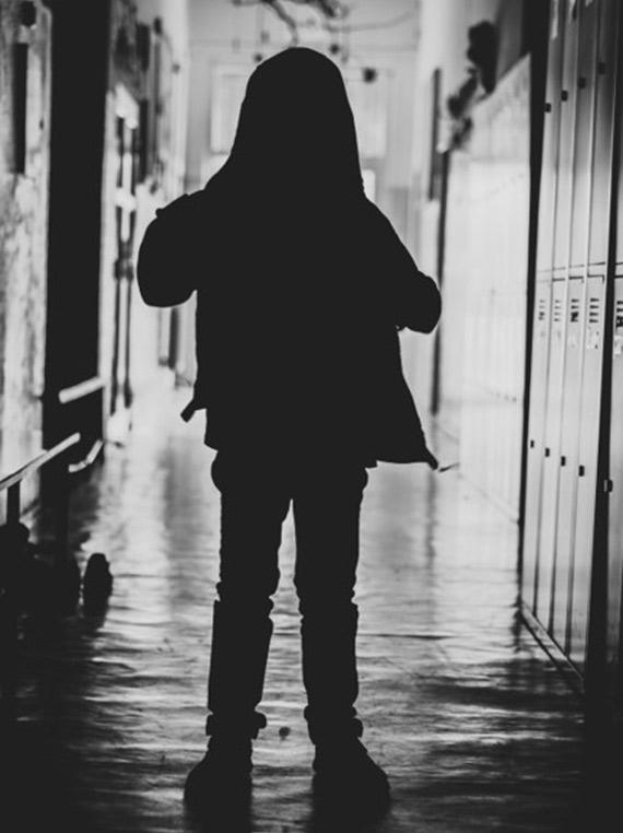 figure in a dark corridor