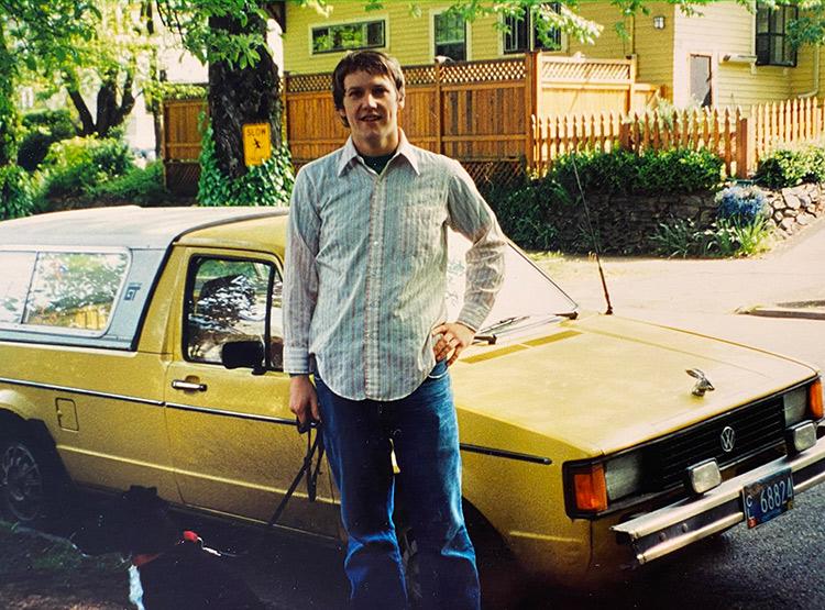 young man near a car