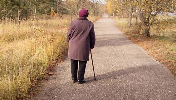 elderly woman walks